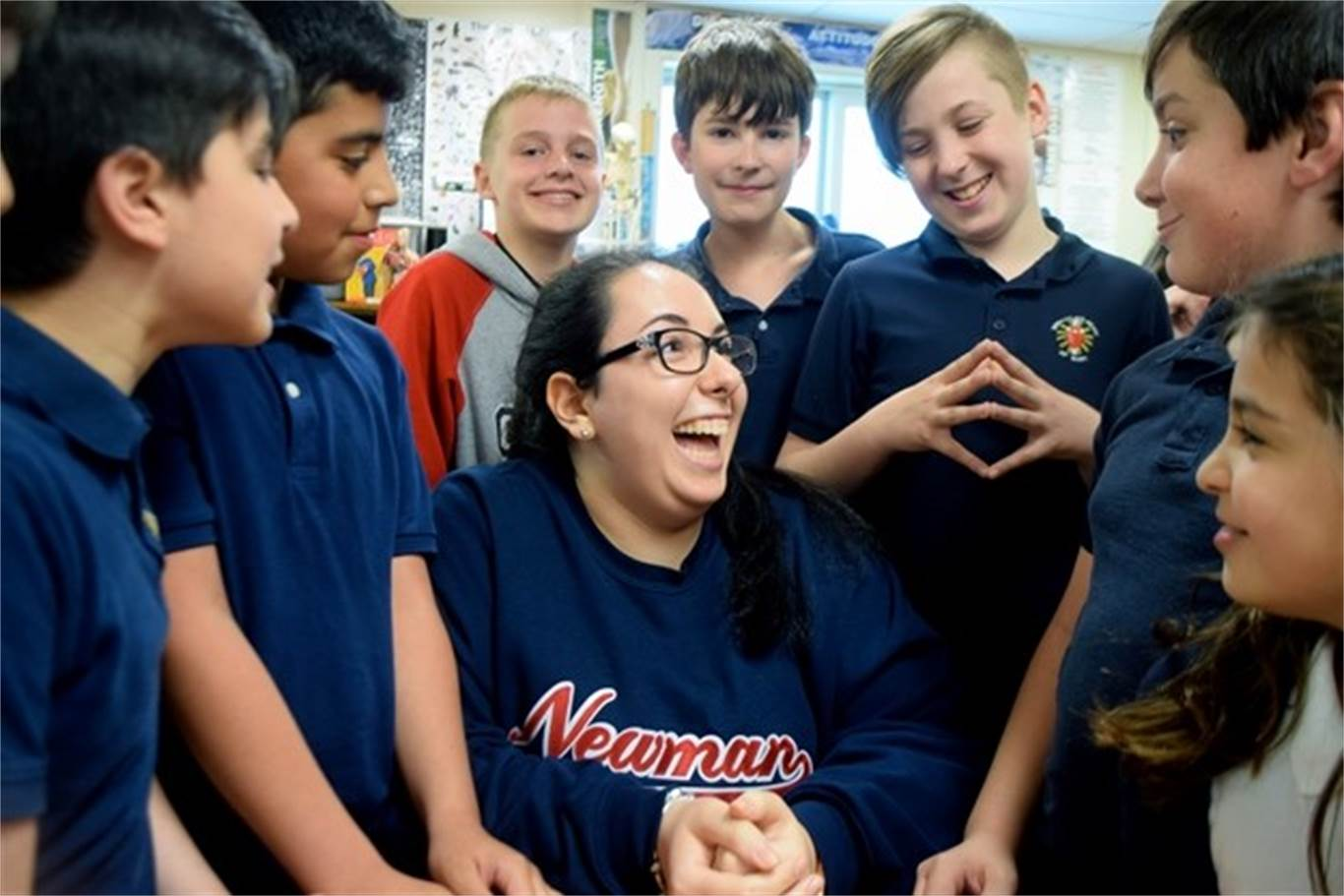 Lucia Marchionda, middle, hangs out with Grade 6 students at St. Gabriel Catholic Elementary School, where she helps out five times a week in the afternoons. The 17-year-old Cardinal Newman Catholic Secondary School Grade 12 student, who has accumulated more than 3,000 volunteer hours, has been named Stoney Creek Chamber of Commerce's Junior Citizen of the Year for 2017. Photo by Laura Lennie, Stoney Creek News.